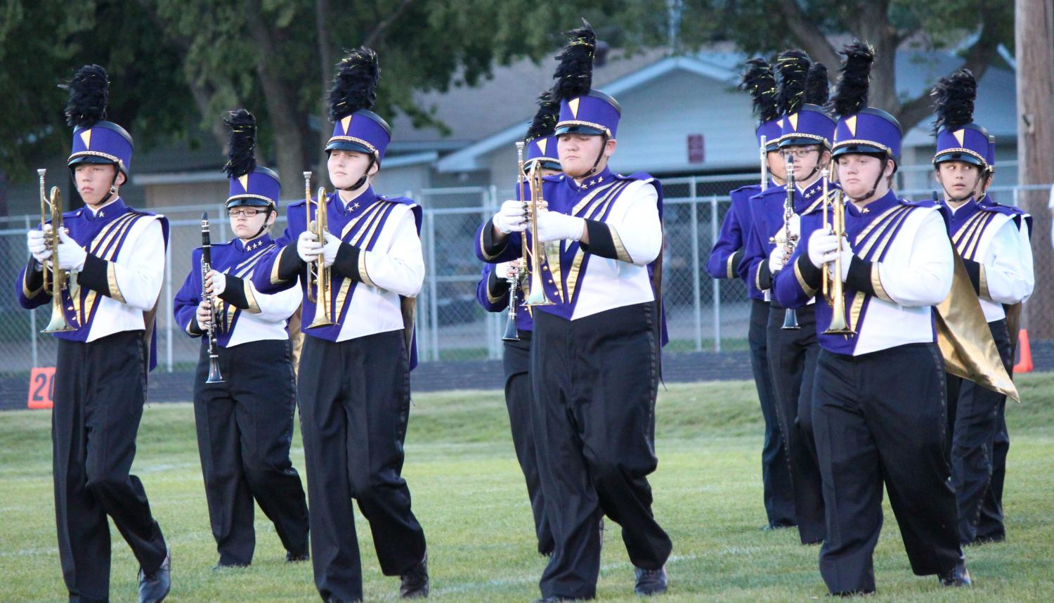 Members of the brass section of the Duster Band perform during a halftime show at a recent football game.