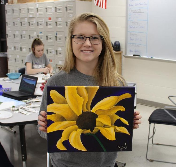 Senior Ashley Woosley holds her piece entitled