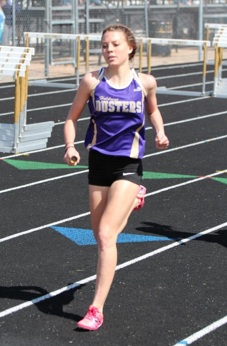 Sophomore Kenzie Hurlbert runs a leg of the 4 X 800 Relay at the GINW Invite.