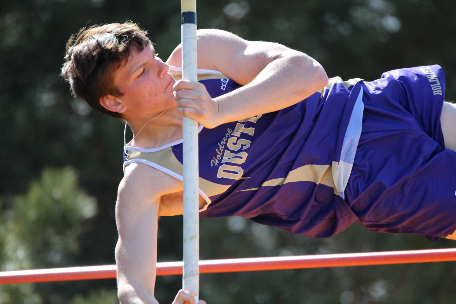 Sophomore Nathan Anderson vaults successfully in the GINW Invite.