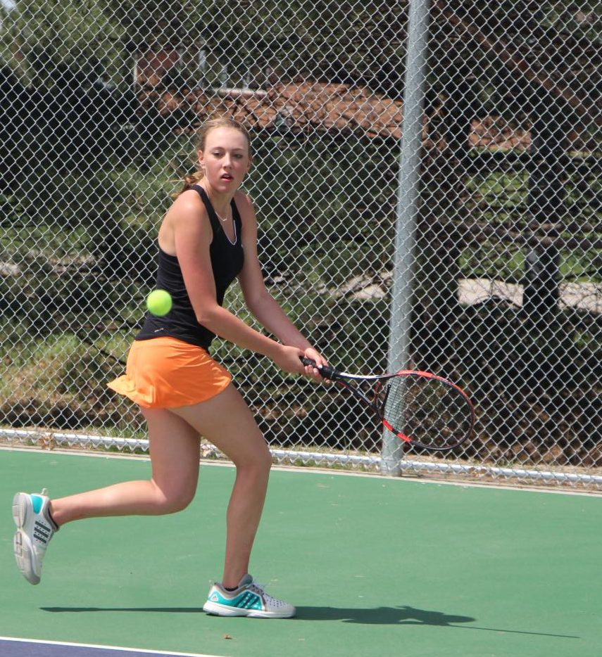 Senior Bryn Boyken prepares to return a volley from a GICC opponent in a recent dual.