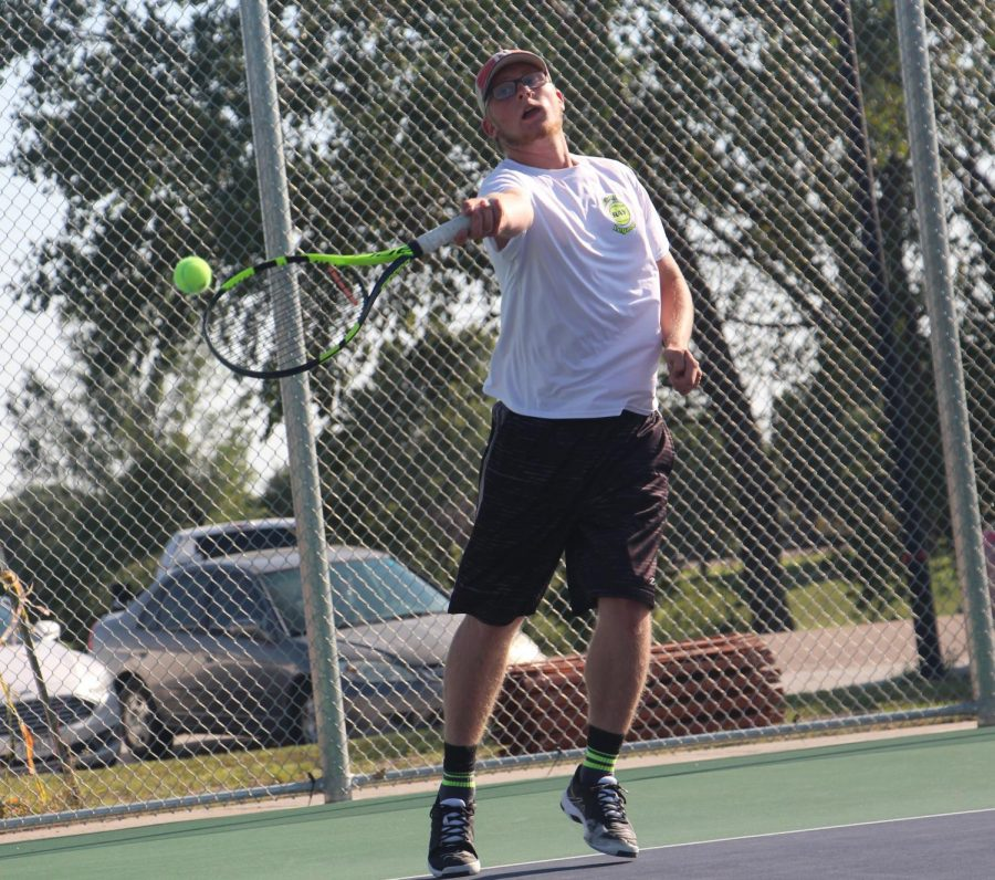 Junior Eli Borden returns a volley during a recent dual match at North Park.