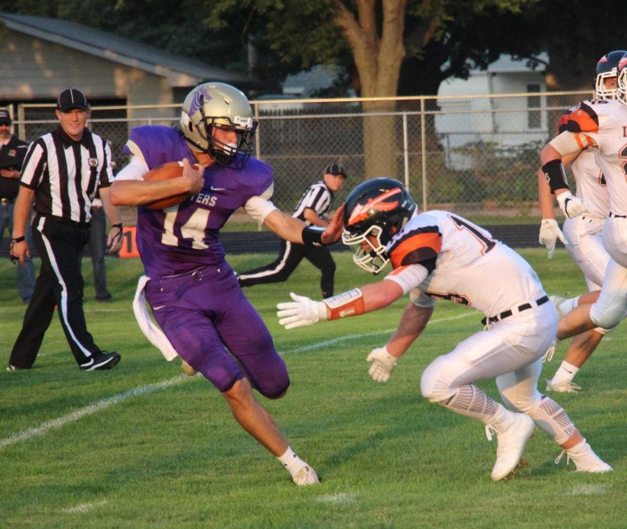 Stiff+arming+an+Ogallala+linebacker%2C+senior+Drake+Johnson+runs+for+a+first+down+in+the+first+game+of+the+season.