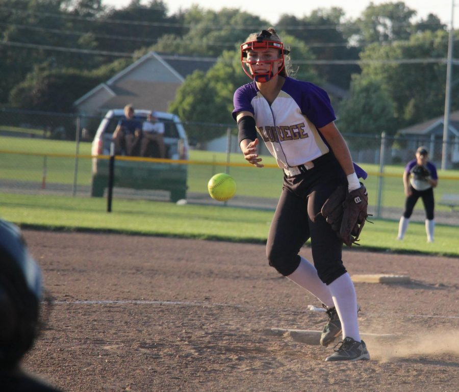 Following through, pitcher Morgan Hein fires the ball home during a game versus York.