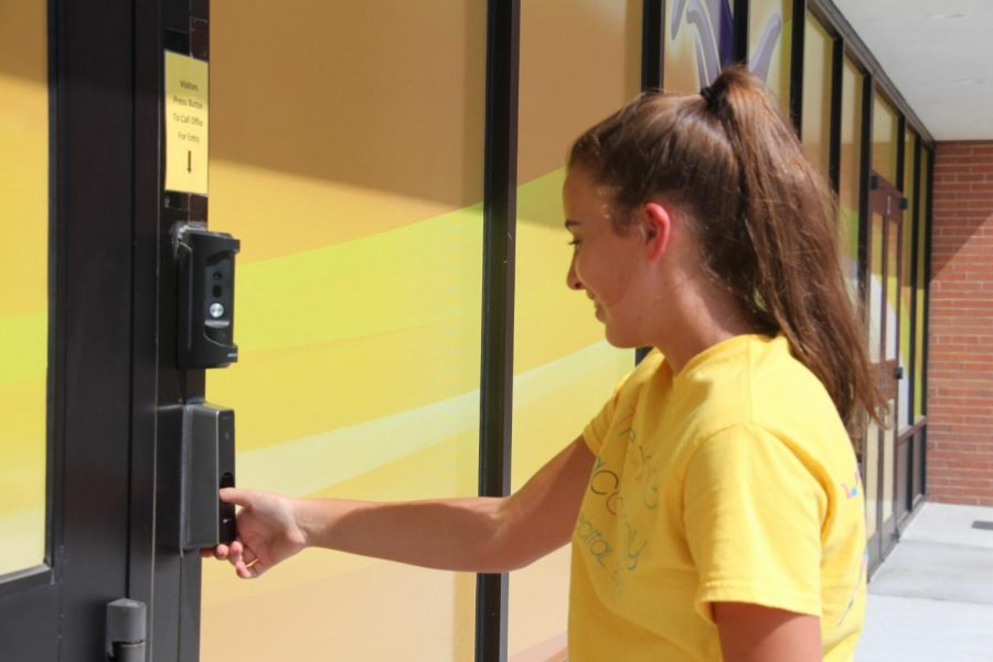 Entering+the+front+doors+of+HHS%2C+sophomore+Avery+Michalski+uses+the+thumb+print+scanner+to+unlock+the+door.