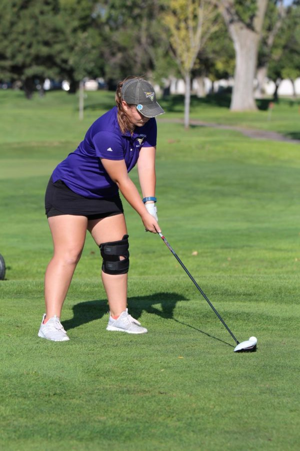 Amanda Taylor tees up the ball on the Number Five tee box at the Holdrege Invitational.