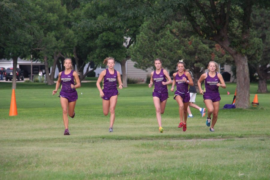 Competing at the Holdrege Time Trials, the girls' cross country team takes off at the start.
