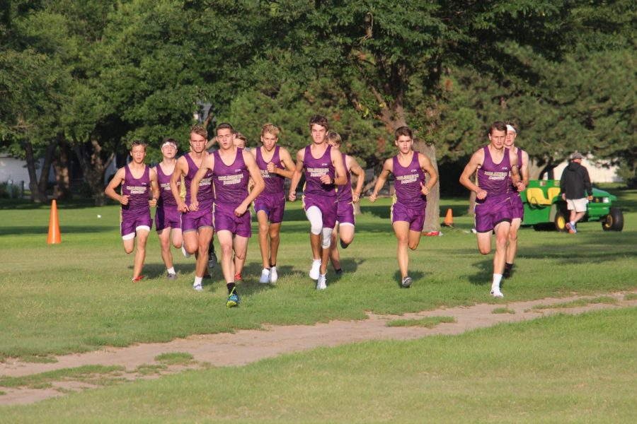 Taking off at the start of the Holdrege Time Trials, the boys' cross country team begins attacking the course.