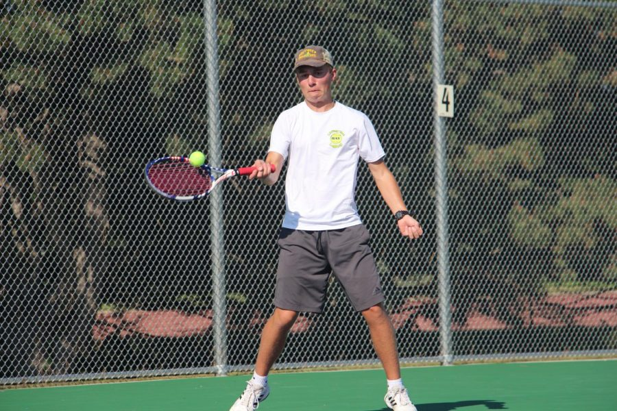 With his eyes on the ball, Garrett Ehrenberg returns a volley during a dual at North Park.