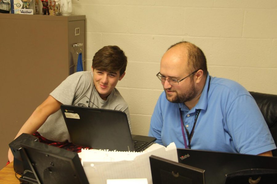Mr.+Enchayan+helps+freshman+Brandon+Carpenter+on+a+problem+on+his+homework+assignment.