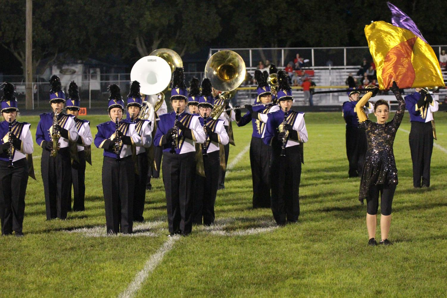 Members of the HHS Marching Band perform during the halftime of a recent football game.
