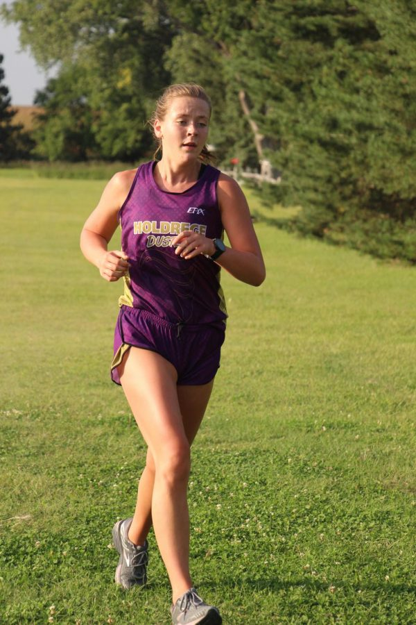 Competing at the Holdrege Time Trials, senior Kelsey Belgum strides out toward the finish line.