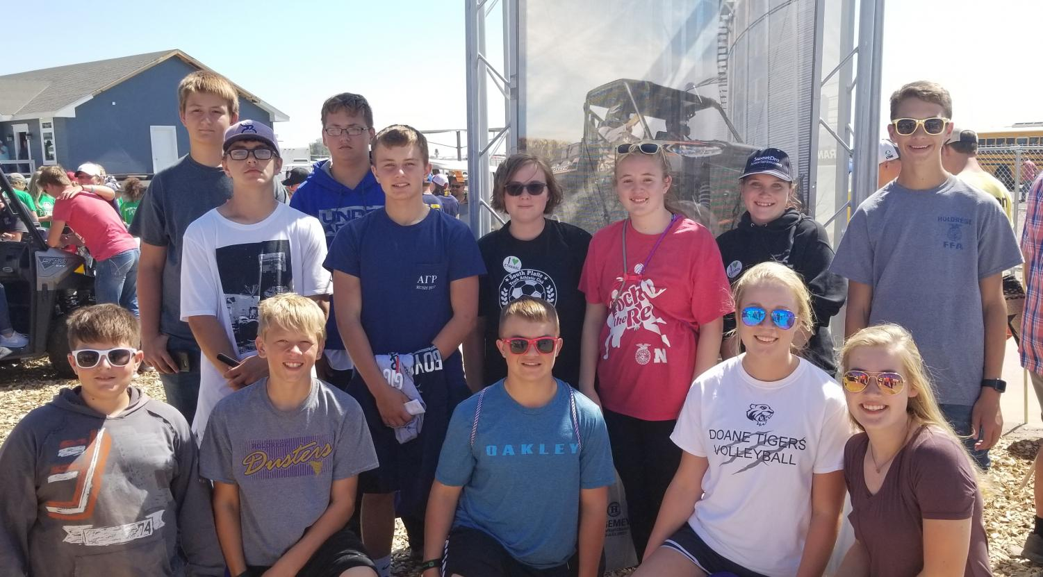 Introduction to Agriculture Class Attendees to Husker Harvest Days: Front Row:  Caid Bailey, Hunter Ness, Mason Marquart, McKenna Ortgiesen. Bailey Edgren.  Back Row Standing:  Gabe Greenlee, August Wick, Braxten Krejci, Jeremiah Johnson, Alexis England, Erika Wilkins, Anna Thomas, Kade Komenda