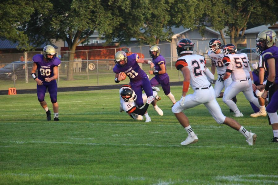 Senior Gage Holt gains yards versus Chase County earlier in the season.