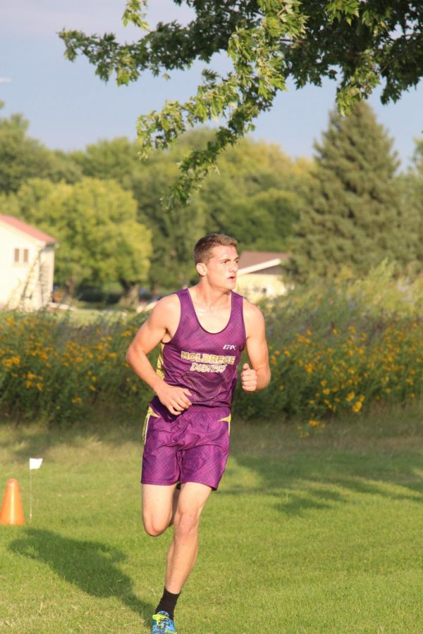 Running at the Holdrege Time Trials, senior Tyler Peterson heads toward the finish line.