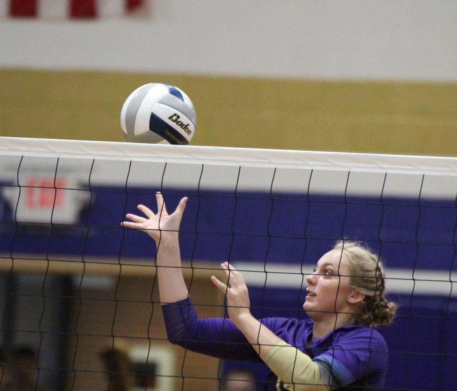 Senior Sierra Schemper competes at the net in a recent home game.