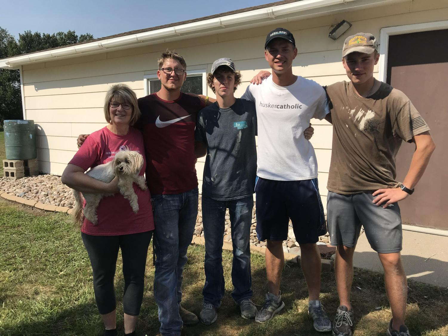 Four members of the tennis team - Eli Borden, Harrison Elliot, Parker Hamling and Garrett Ehrenberg - helped Karla Ruybalid around her home on