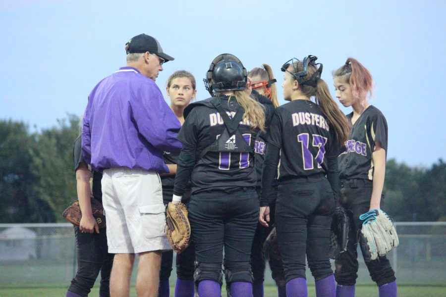 Coach Freburg meets with the team during the Southern Valley game.