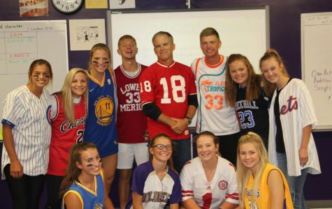 Members of the yearbook staff show off their school spirit during Jersey Day.