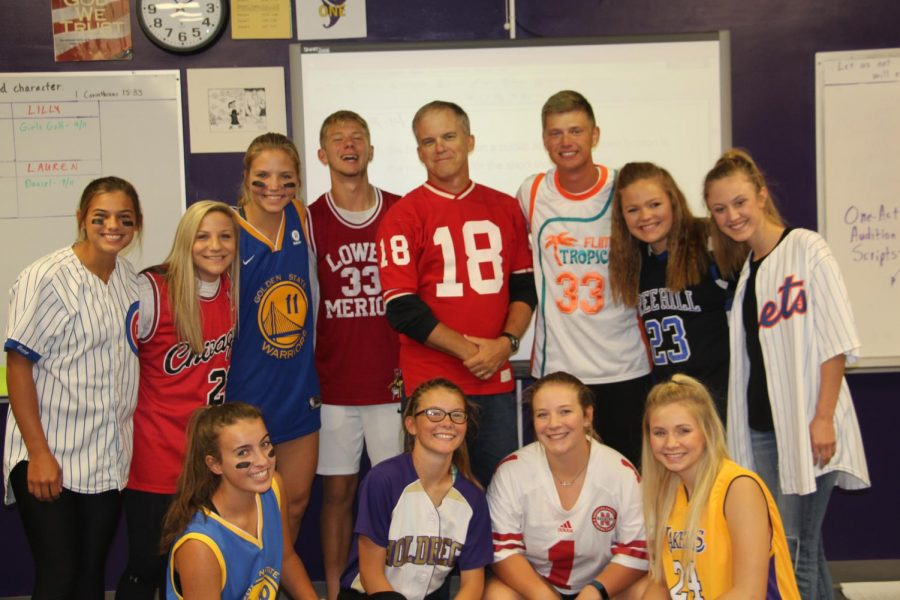 Members+of+the+yearbook+staff+show+off+their+school+spirit+during+Jersey+Day.