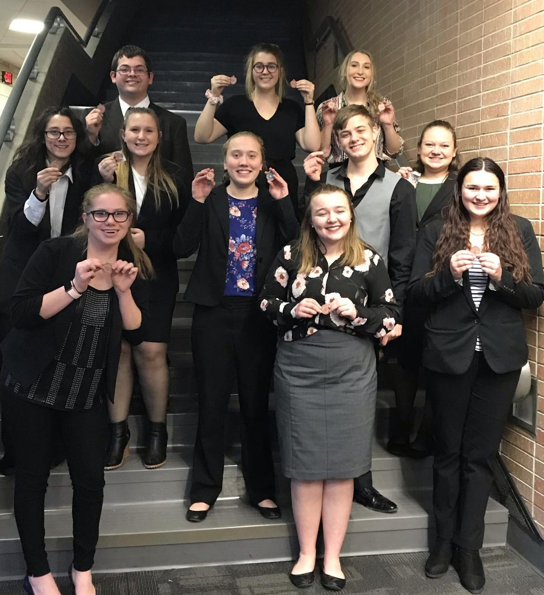 Holdrege Speech team members show off their CNFL #2 medal.