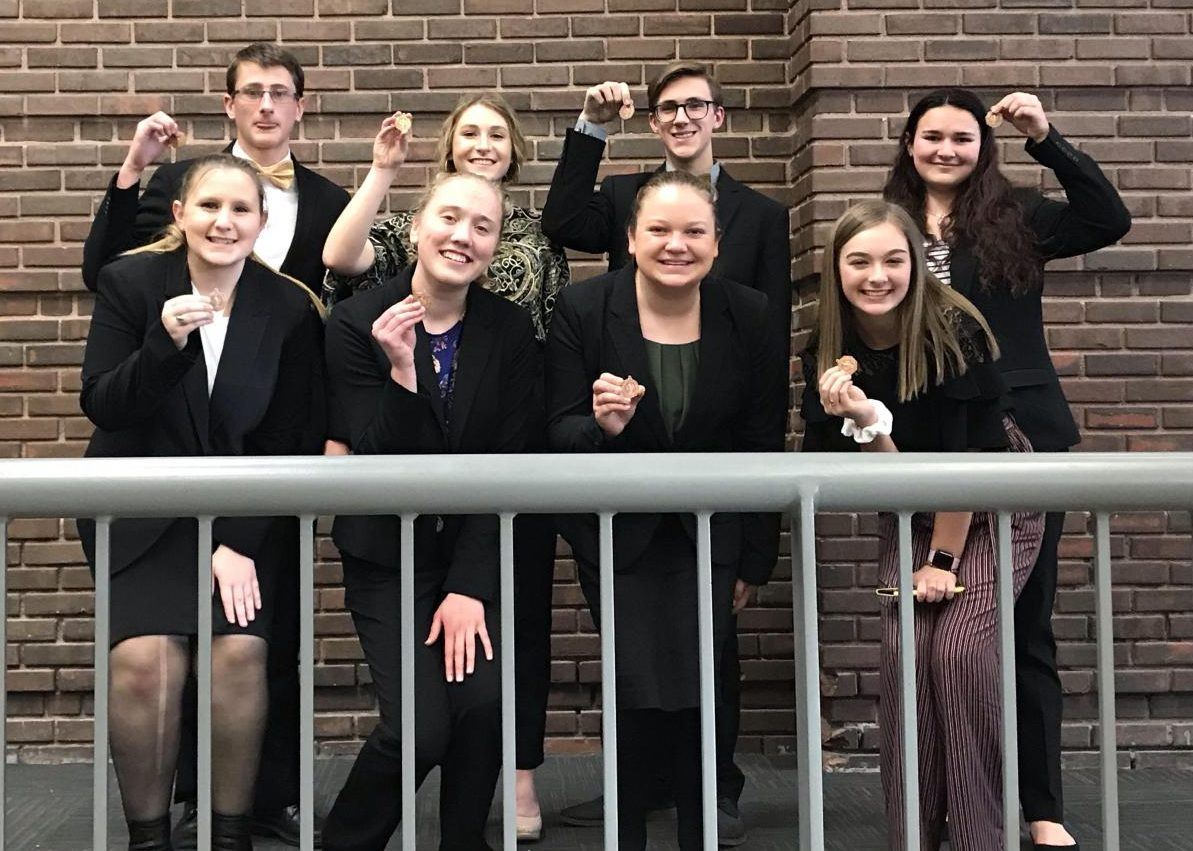 Speech team members display their medals after the Lexington Speech meet.