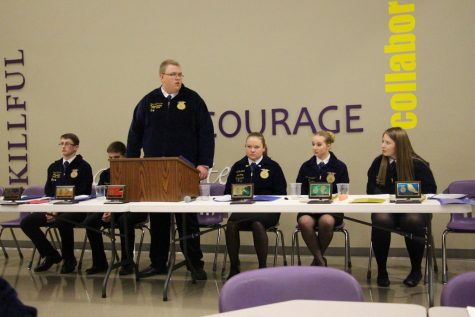 FFA Officer Tyler Badertscher leads a procedure during the Leadership Banquet at the Holdrege Elementary.