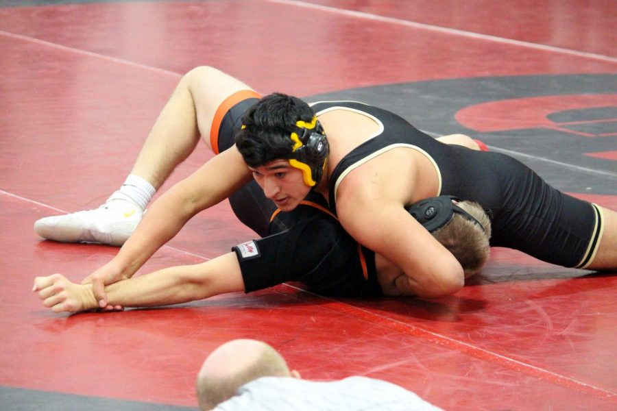 Junior Imanol Munoz pins an opponent in the Sidney Invitational earlier this season.