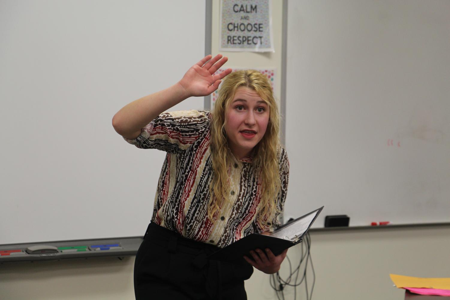 Senior Amanda Envick performs her Serious Prose speech during the Speech Showcase.