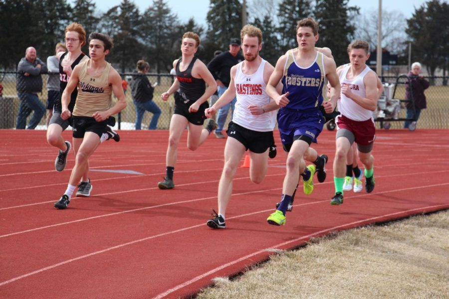 Senior Tyler Peterson takes off during the start of the 1600 at the Hastings Invite.