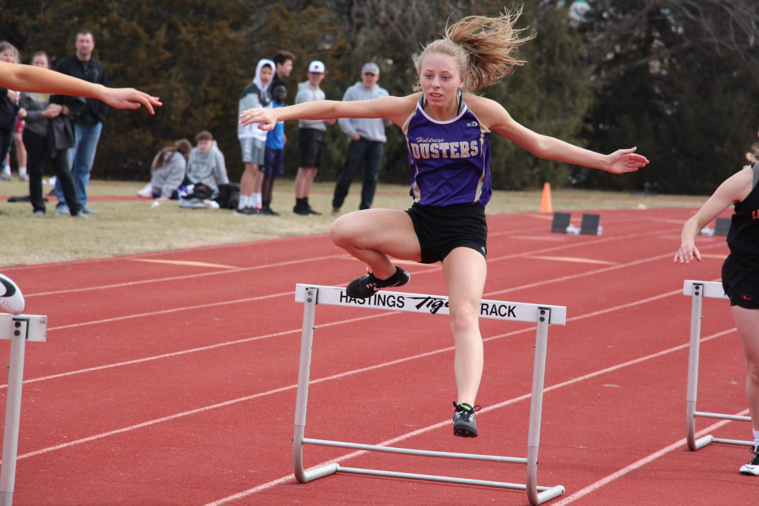 Senior Jenna Karn clears the first hurdle during the 300 Low Hurdles at the Hastings Invite.