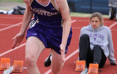 Sophomore Jacob Drain takes off out of the blocks during the 100 meter finals at the Gothenburg Invite.