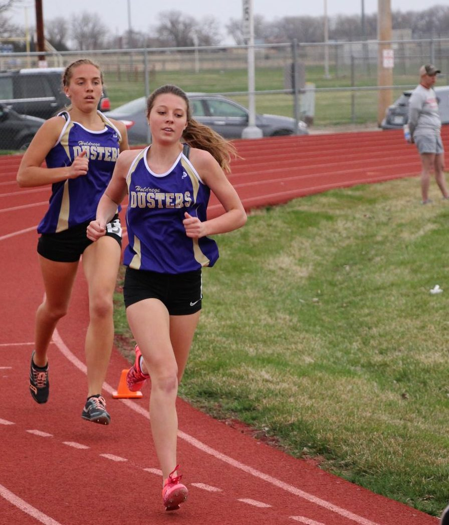 On the last lap of the 800 at the Gothenburg Invite, Sydney Reed and Kenzie Hurlbert head down the backstretch.
