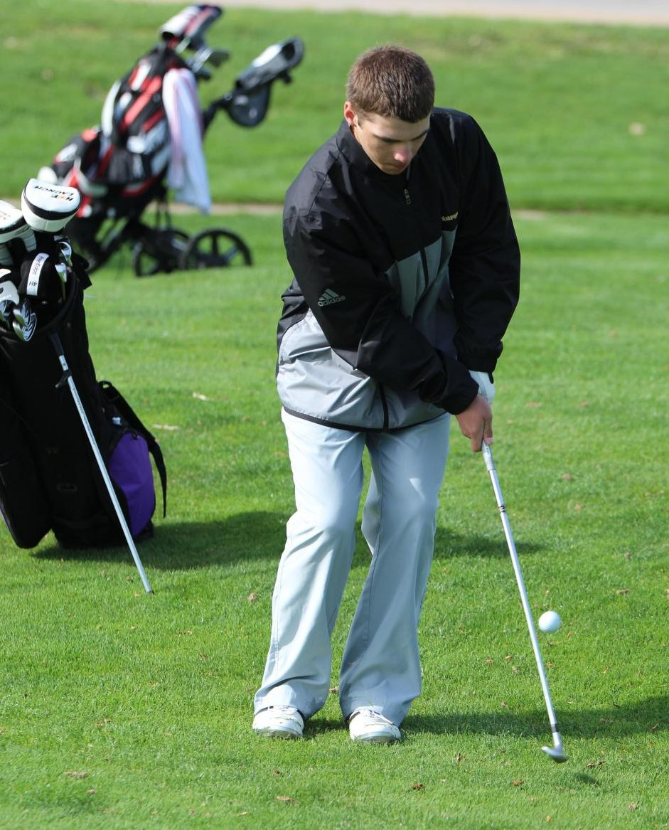 Chipping in on hole number two, Damon Taylor keeps his eye on the ball during the Holdrege Invite.
