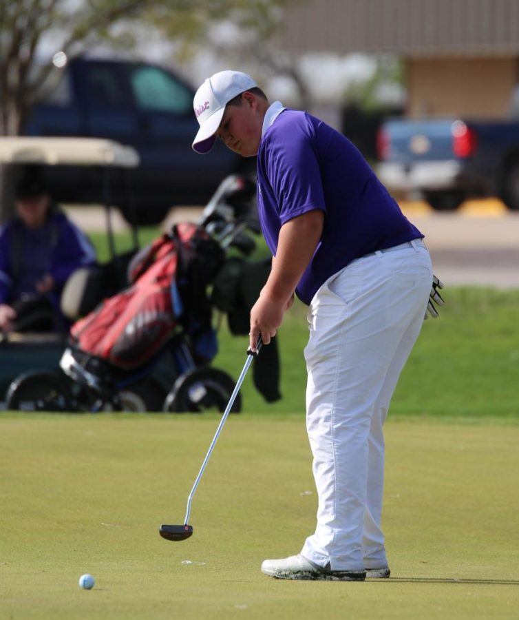 Sophomore+Josh+Reed+watches+his+putt+roll+toward+hole+number+two+during+the+Holdrege+Invite.